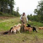 Jak Peckitt surrounded by gundogs
